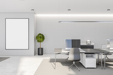 White Poster With Copyspace In Black Picture Frame On Light Wall In Modern Interior Designed Coworking Office With Carpet On Marble Floor And Stylish Tables And Chairs. Mock Up
