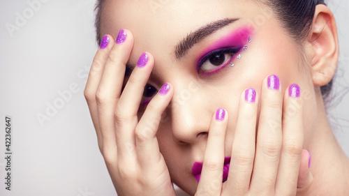 Fotografiet Asian female closeup colorful eyeshadow with extreme long false eyelashes