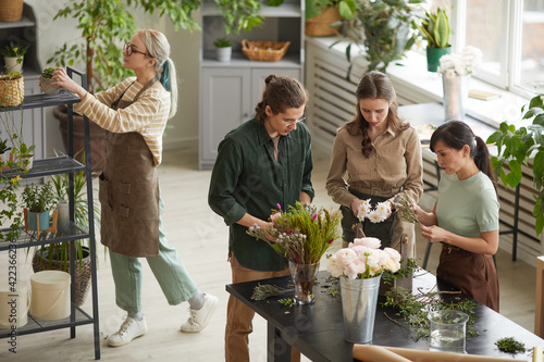 Fotografie, Tablou High angle view at diverse group of young florists creating floral compositions