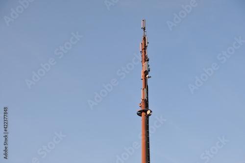 Fényképezés 5G Telecommunication tower antenna  on evening sky background