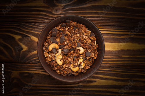 Fototapeta Chocolate granola cereal with nuts in a bowl. obraz
