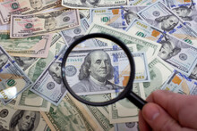 Magnifying Glass On The Background Of Bundle Dollars - Texture, Background