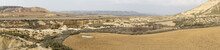 Panorama View Of The Desert Grasslands And Mesas And Table Mountains In The Bardenas Reales Desert In Northern Spain
