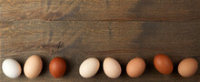Natural Colored Gradient Easter Eggs Line On Wooden Background. Minimal Easter Concept.