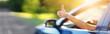 Leinwandbild Motiv Woman inside her car gesticulate thumb up