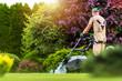 Leinwandbild Motiv Residential Garden Worker Trimming Backyard Lawn