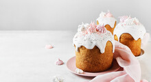 Traditional Russian Easter Cake With Marshmallow, Sweet Filling, With Icing And Confectionery Sprinkles As Decoration On Pink Plate. Light Easter-Orthodox Holiday Background.Banner.