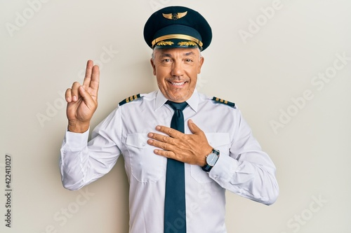 Handsome middle age mature man wearing airplane pilot uniform smiling swearing w Poster Mural XXL