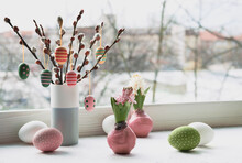 Easter Decorations On Windowsill, Panoramic Image. Wooden Painted Eggs On Pussy Willow. Hyacinth Flowers With Bulbs In Pink Wax. Window, View Over Town. Romantic Indoor Setup. Happy Easter