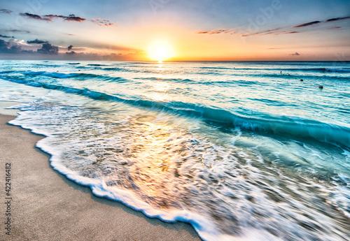 Fototapeta Sunrise over beach in Cancun obraz na płótnie
