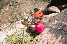 A Mother And Daughter Rock Climbing In Pine Creek Canyon, Red Rock Conservation Area, Las Vegas.
