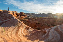 A Woman Hiking The Fire Wave Trail, Valley Of Fire State Park, Overton, Nevada.