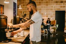 Businessman Having Coffee Break In New Company