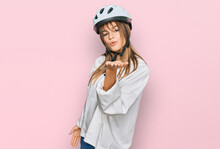 Teenager Caucasian Girl Wearing Bike Helmet Looking At The Camera Blowing A Kiss With Hand On Air Being Lovely And Sexy. Love Expression.