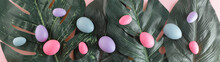 Creative Easter Nature Background. Green Tropical Palm Leaves With Easter Eggs. Minimal Spring Abstract Jungle Or Forest Composition. Contemporary Style.