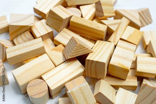 Fotografering Wooden building blocks on white background.
