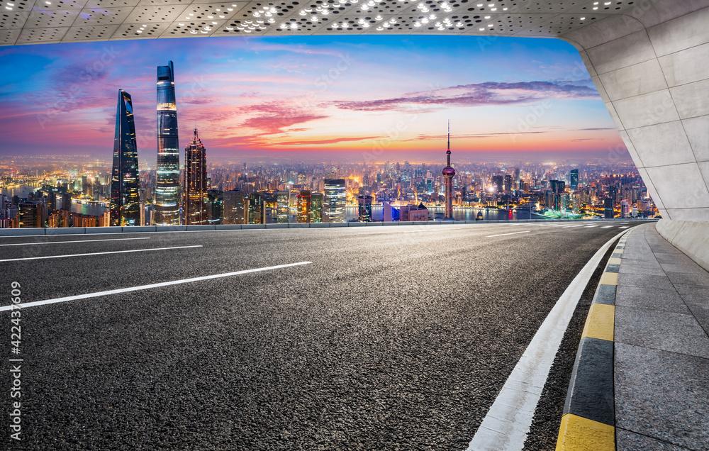 Fototapeta Asphalt road and city skyline at sunrise in Shanghai.