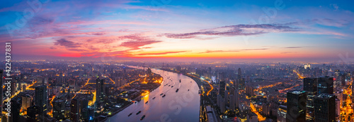 Aerial view of modern city skyline and buildings at sunrise in Shanghai.
