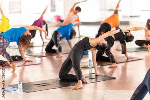 Fotografering Group Of People performing yoga class ,sports and healthcare concept