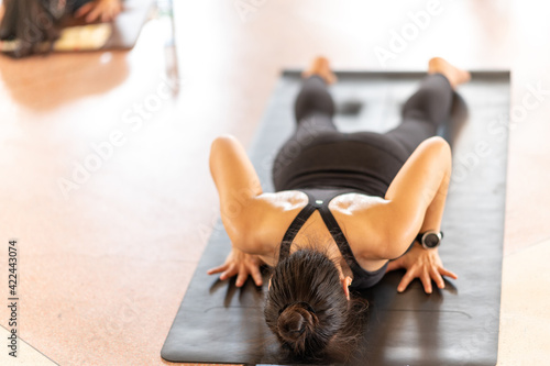 Group Of People performing yoga class ,sports and healthcare concept Fototapete