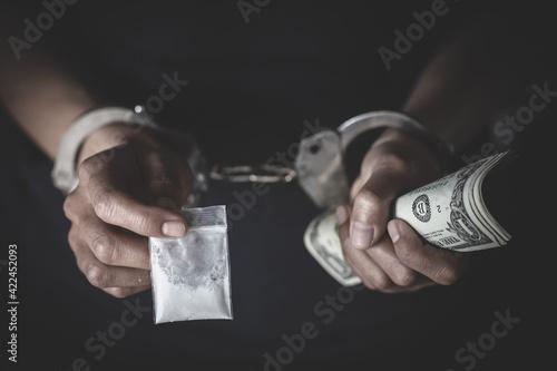 Drug dealer under arrest confined with handcuffs Fototapet