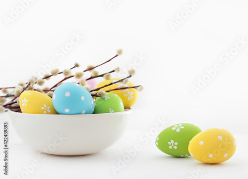 colorful easter eggs and willow branches
