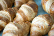 Freshly baked croissants on a plate with different fillings.