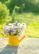 canvas print picture - meadow flowers bouquet in yellow watering can, sunny day. rustic garden still life. summer blossom season. copy space