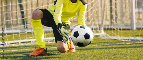 Fotografía Young Football Galkeeper Catching Soccer Ball