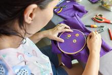 Asian Woman Sewing Handcraft Of Sunflower Pattern