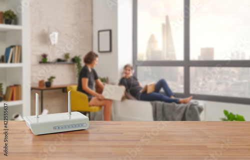 Papel de parede Modem and router box on the table and living room background blur concept