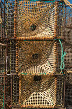 Ropes, Nets And Handcrafted Fishing Traps For The Octopus, Lobsters And Crabs In The Fishing Port