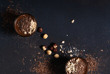 Homemade Dark Chocolate Mousse With Hazelnut In Glasses On Dark Grey Table