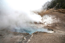 Steaming Geyser Landscapes In Yellowstone National Park.