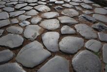 Ancient Cobblestones In Rome - Italy.