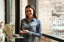 Young Happy Freelancer Pointing With Hand At Laptop