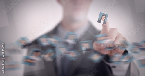 Composition of businesswoman pointing at photo of businesswoman chosen from network