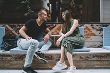 Casual Dressed Male And Female Lovers Enjoying Time For Flirting During Date Time In Sidewalk Cafe, Happy Diverse Hipster Guys Discussing Positive Friendship And Relationship Smiling Outdoors