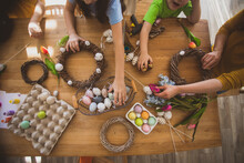 Making Homemade Easter Wreath Of Vines Decorated With Eggs