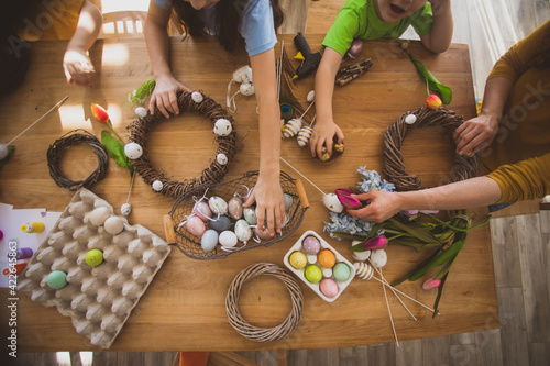 Fototapeta Making homemade Easter wreath of vines decorated with eggs obraz