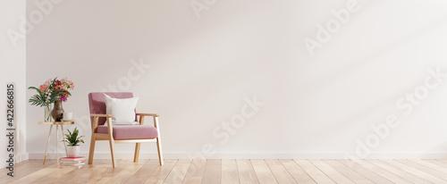 Fototapeta Modern minimalist interior with an armchair on empty white wall background. obraz