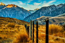 Rural Farm Fencing Running Through The Valley Towards The Snow Covered Southern Alps In The Background