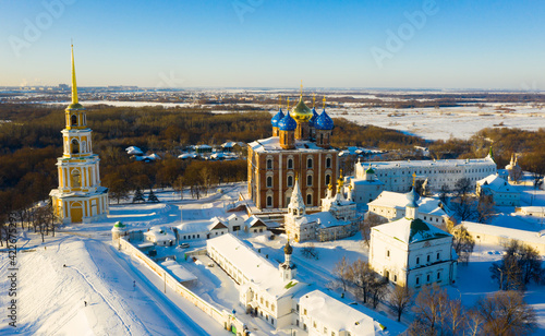 View from drone of architectural ensemble of Ryazan Kremlin with churches and cathedrals covered with snow on winter day, Russia..