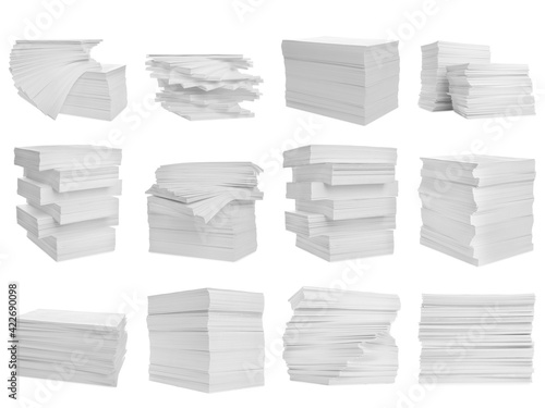Fototapeta Set with stacks of blank paper on white background obraz