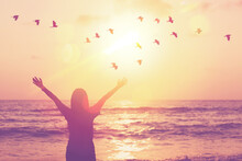 Copy Space Of Woman Raise Hand Up On Sunset Sky At Beach And Island Background.