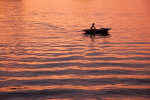 Silhouette Of The Fishman In The Boat At The Sunset, Halong Bay, Vietnam