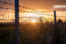 Fence In A Sunset