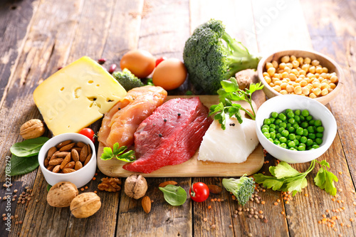 Fototapeta protein food sources on wood background obraz
