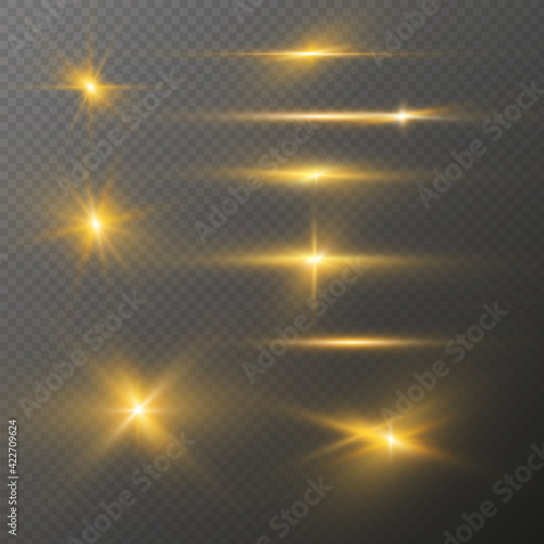 Fototapeta Set of realistic light glare, highlight. Collection of beautiful bright lens flares. Lighting effects of flash. Golden glitter shining stars, sun sparks  on transparent background. Vector EPS10 obraz