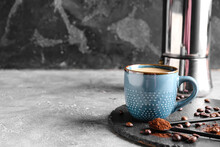 Cup Of Tasty Hot Coffee On Grunge Background